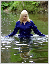 Modesty gets her blue boilersuit absolutely soaking wet! featuring Modesty, the wild child